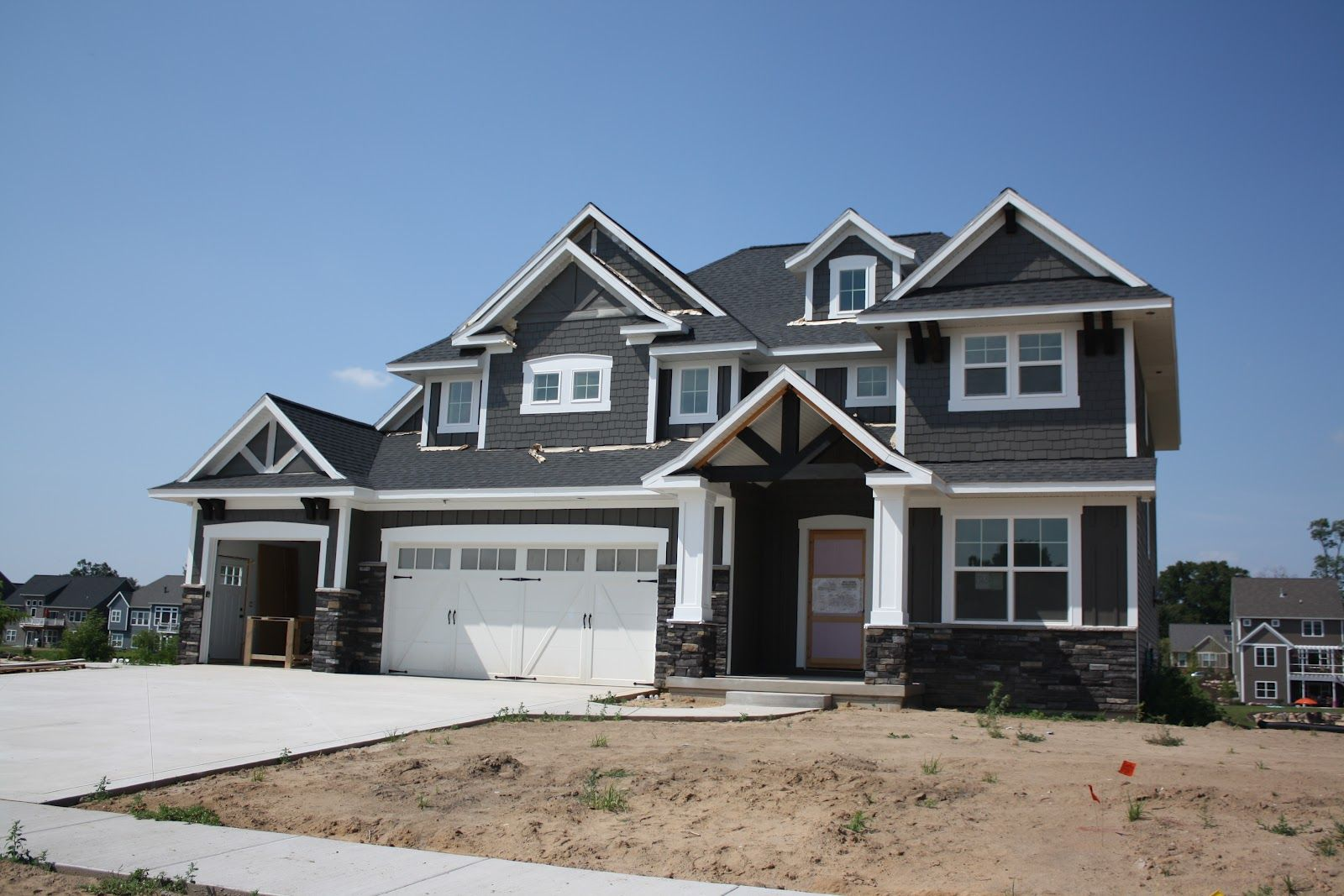 The white trim has yet to be painted but that didnt stop - Grey house exterior with white trim ...