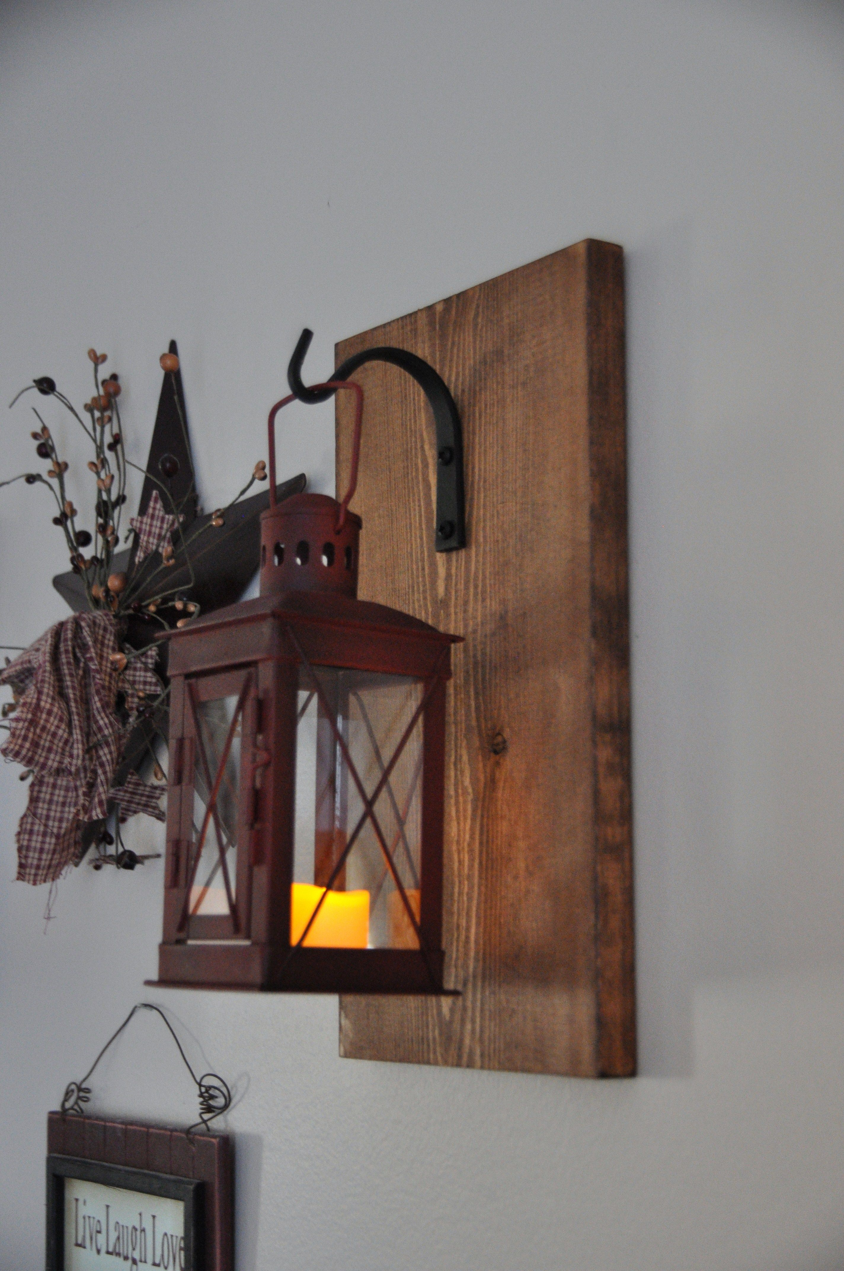 Rustic wood farmhouse style candle holder with red metal lantern