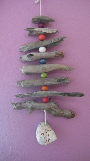 Modify this idea into a Christmas tree mobile made with driftwood & shells to hang out on balcony.