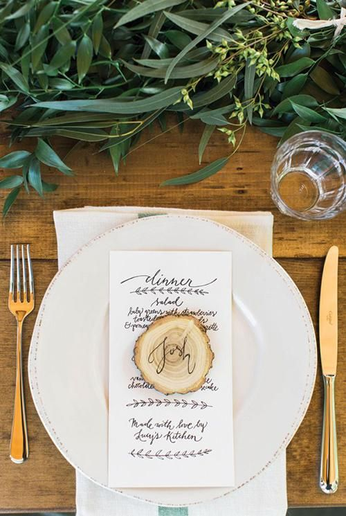 Calligraphed wood slices are the definition of rustic elegance | Brides.com
