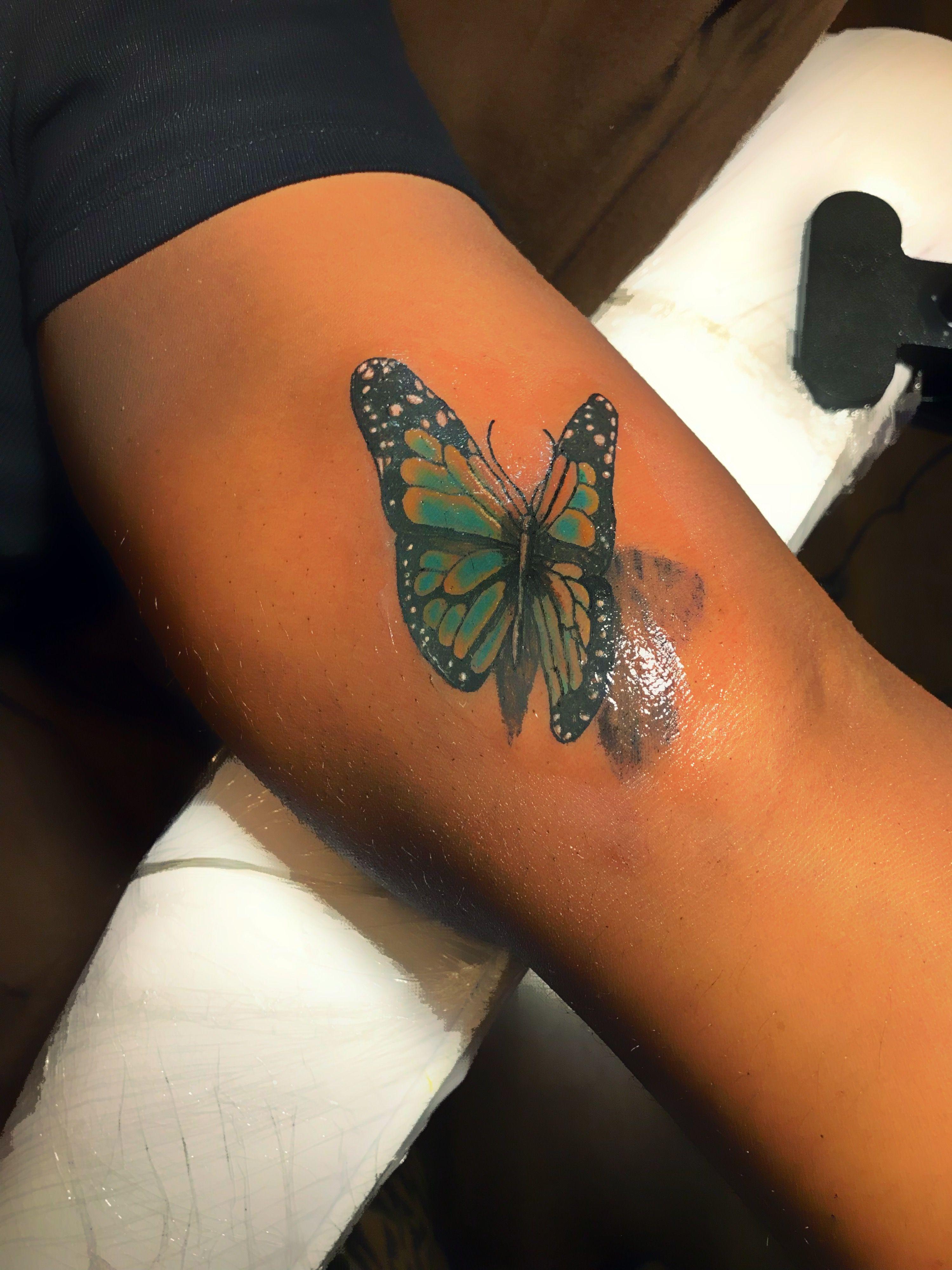 Butterfly colour tattoo on Dark skin Small tattoos, Body