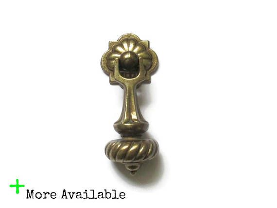 This listing is for 1 large vintage drop pull and the single screw