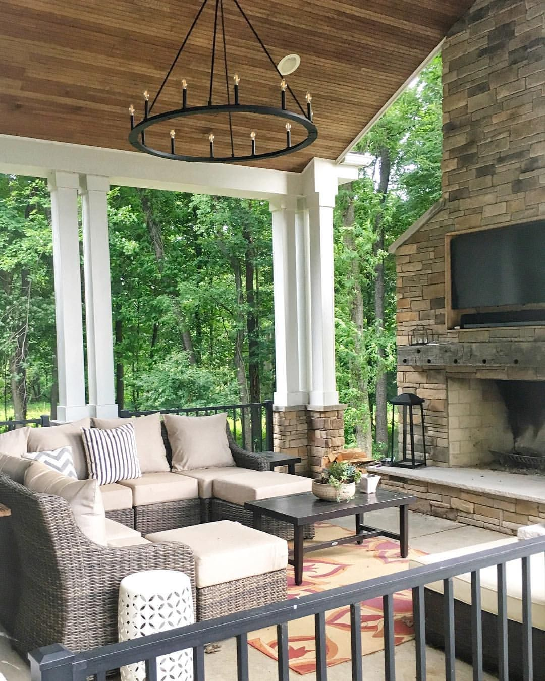 Modern Farmhouse Porch With Outdoor Stone Fireplace Sectional And Outdoor Chandelier Outdoordecor Out Outdoor Stone Fireplaces Outdoor Living Outdoor Decor