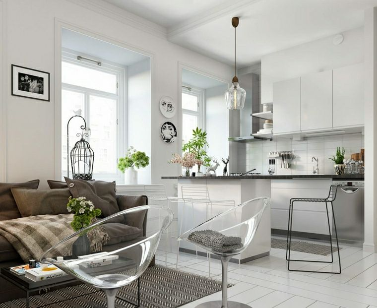 Arredamento loft dal design moderno con una cucina a vista bianca