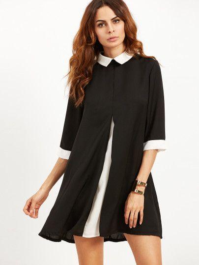 Schwarzes kleid mit weibem kragen und manschetten