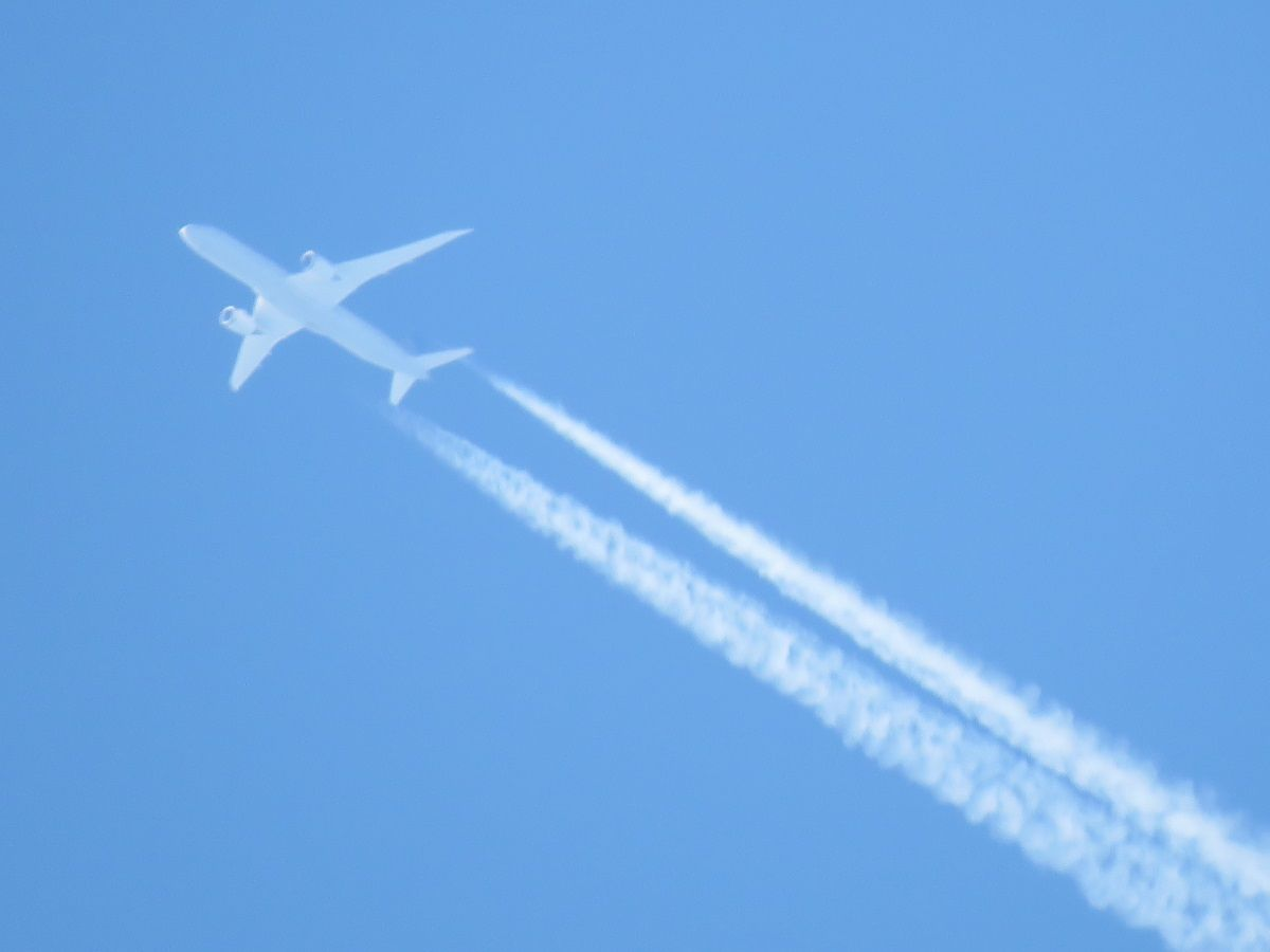 a flying aircraft with contrail. 26 June 2016