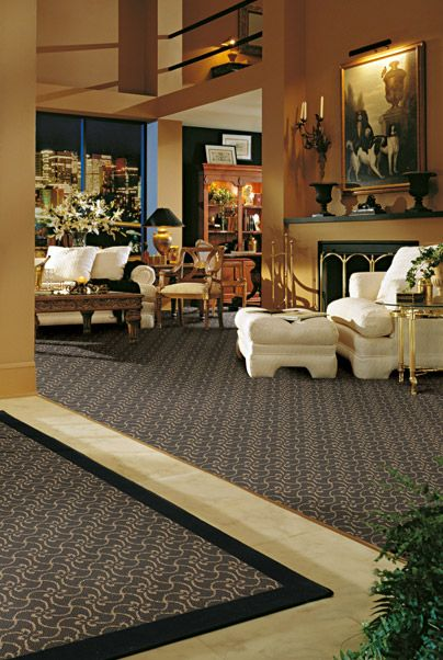 Tile And Carpeting Mix Together To Create A Striking Between Rooms Extraordinary Best Living Room Carpet Creative