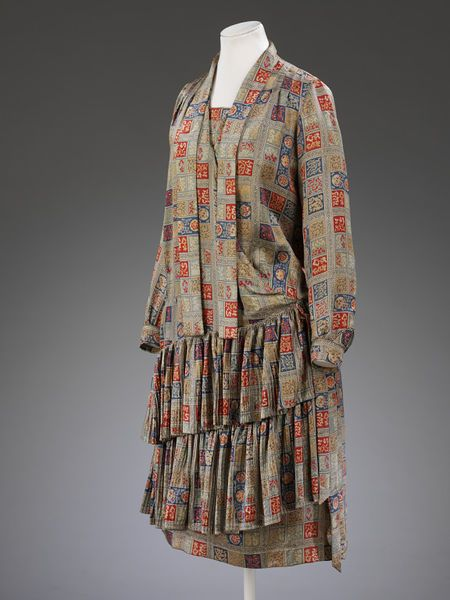Block-printed satin dress 1928 made for Liberty, London. This dress was worn by Marian Hazel Lasenby for her wedding to William Moorcroft in 1928. She recalled that the pattern of the coat was made so that she could wear it either side out. (hva)