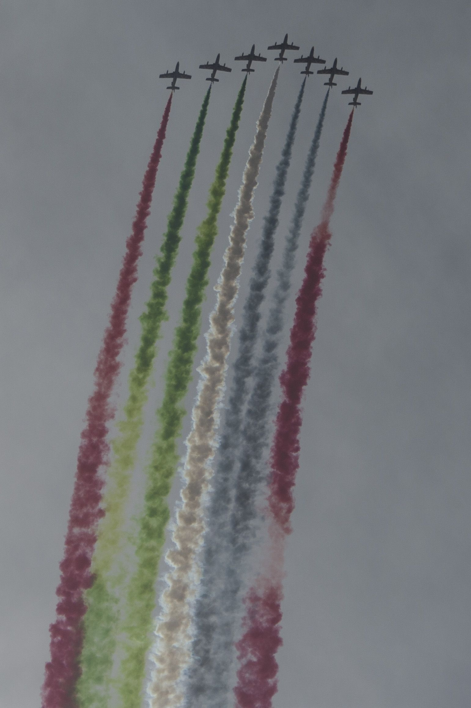 The United Arab Emirates Air Force Al Fursan demonstration team perform at the Bahrain International Airshow at Sakhir Airbase in Manama, Bahrain, Jan. 22, 2016. The Al Fursan planes are painted in black, gold, white, red and green colors and are equipped with smoke generators producing red, green, white and black smoke which are their national flag colors. (U.S. Air Force photo by Staff Sgt. Corey Hook/Released)