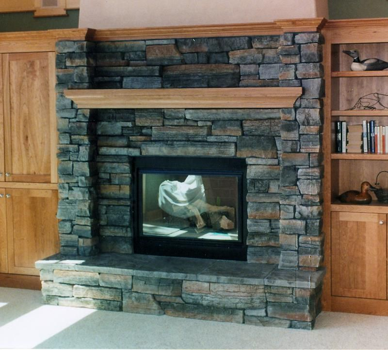 stone fireplace surround boosting warm ambience at home ruchi designs - Fireplace Surround Design Ideas