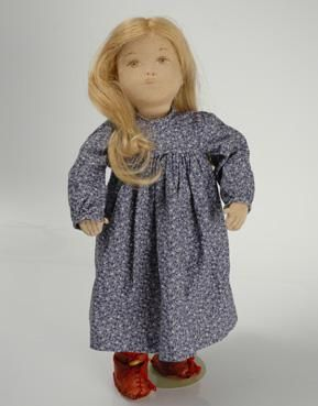 A cloth stuffed Sasha Course doll, with a reddish-blonde human hair wig, original floral Studio-style fashion, all handcrafted under the guidance of the artist or her apprentice and assistant Trudy Löffler in Zürich, Switzerland, estimated between 1955-78, by Sasha Morgenthaler.