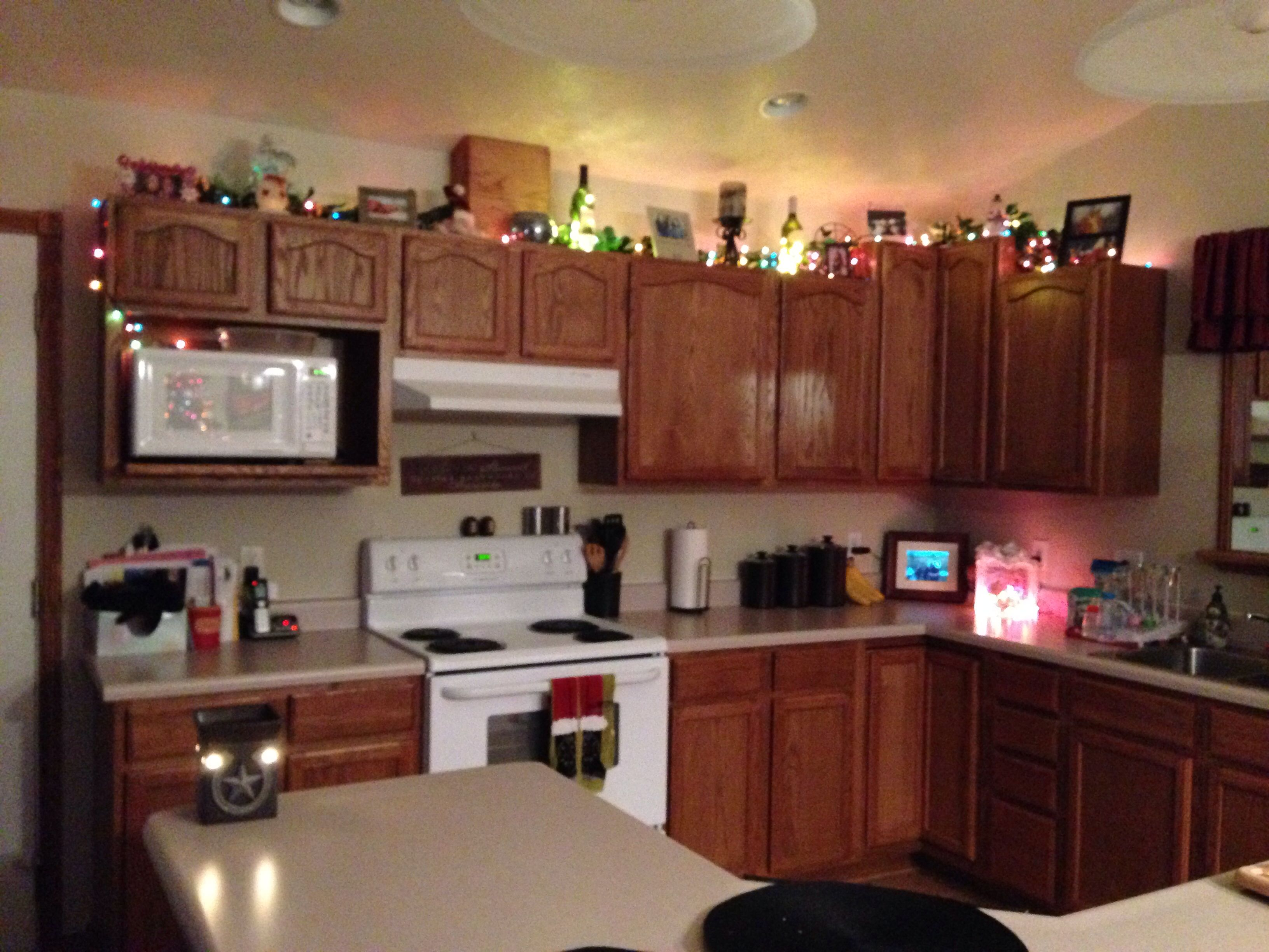 christmas decor on top of cabinets in half of my kitchen apartment deco decor top of cabinets on kitchen cabinets xmas decor id=51837