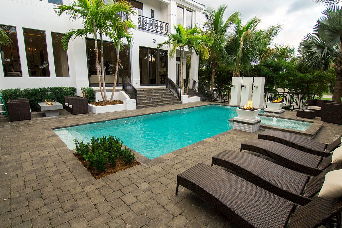 Design your pool deck with the rustic appeal of antiqued pavers ...