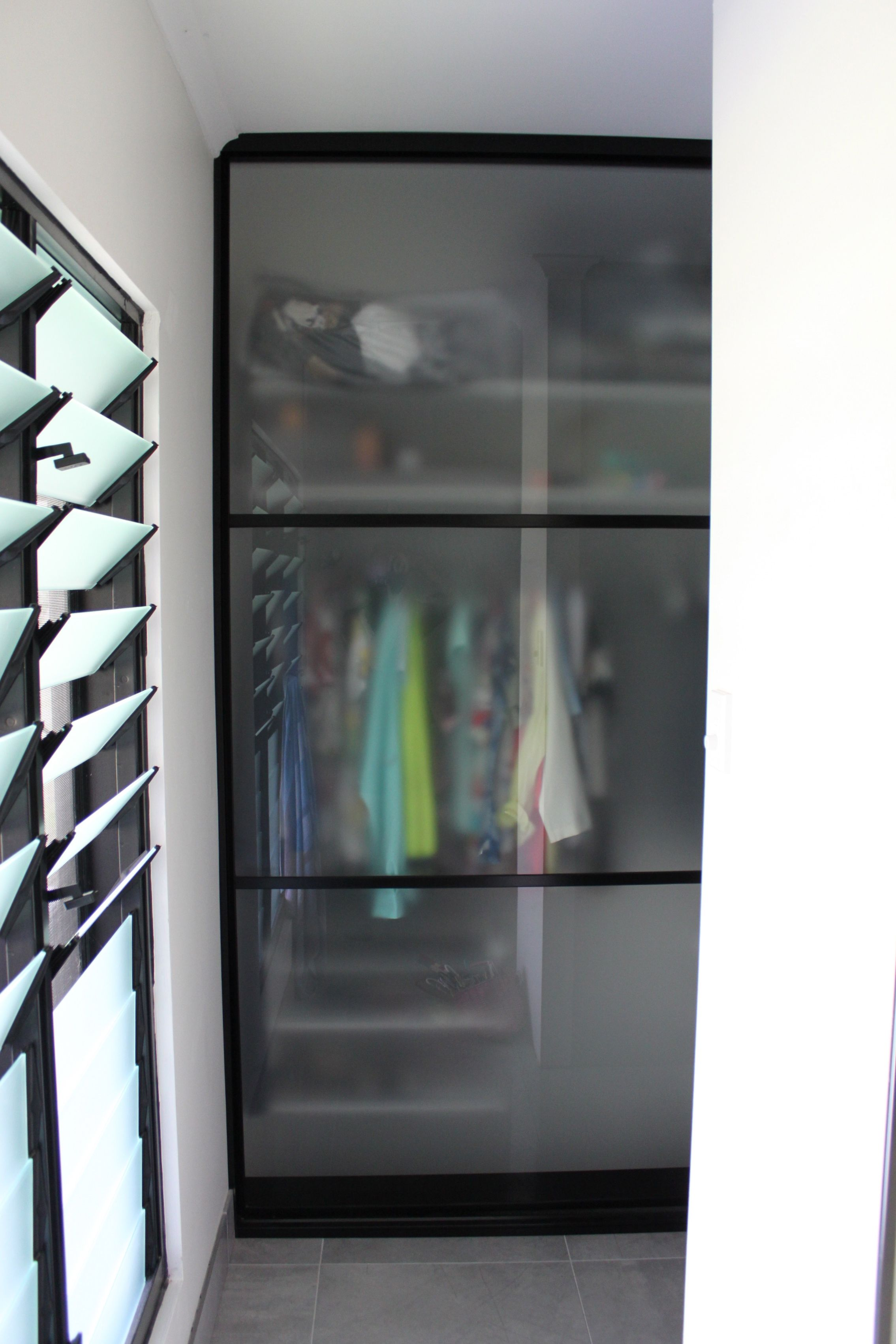 Nice 3 Panels Sliding Closet Doors Using Frosted Glass With Black Frames