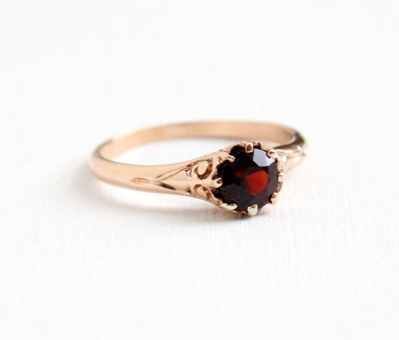 9579faedfed937 Antique Victorian Era 14k rose gold ring featuring a prong set deep red  garnet stone. Beautiful intricate setting with a swirled filigree crown