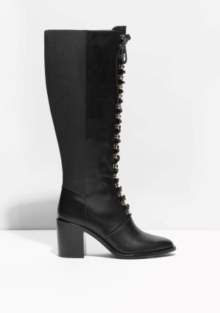 79871558fbc Lace-up styled leather boots with an elegant ankle-climbing top and a chunky  high heel.