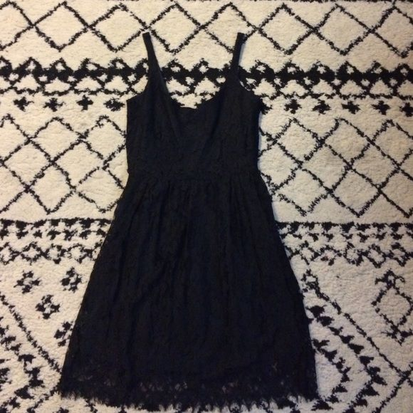 BB Dakota Black Lace Cocktail Dress Lovely black cocktail dress from BB Dakota. Work once. Thicker lace spaghetti strap with low plunging scoop back. Beautiful and timeless piece. Great with tights or bare legs (versatile for all seasons!). Size 4! BB Dakota Dresses