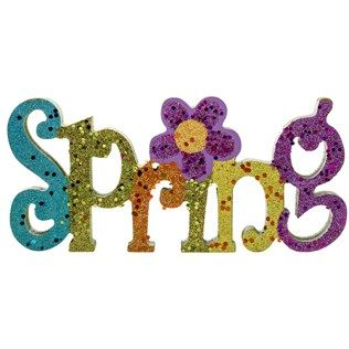 "Sparkle and shine your way to springtime beauty with Glitter Spring Wood Table Piece. This shimmery piece features blue, green, orange, yellow, and purple glitter MDF letters with a purple flower. It is perfect for adding to your centerpiece or for setting alone on your mantel, bookshelf, windowsill, desk, or counter.    	     	Dimensions:    	  		Length: 3/4""  	  		Width: 8 3/8""  	  		Height: 3 7/8""      	     	Full Text: Spring"