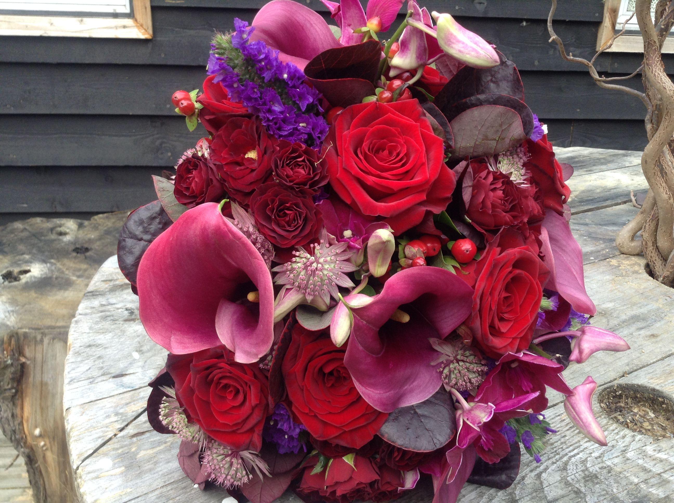 deep purple and red wedding flower bouquet. www