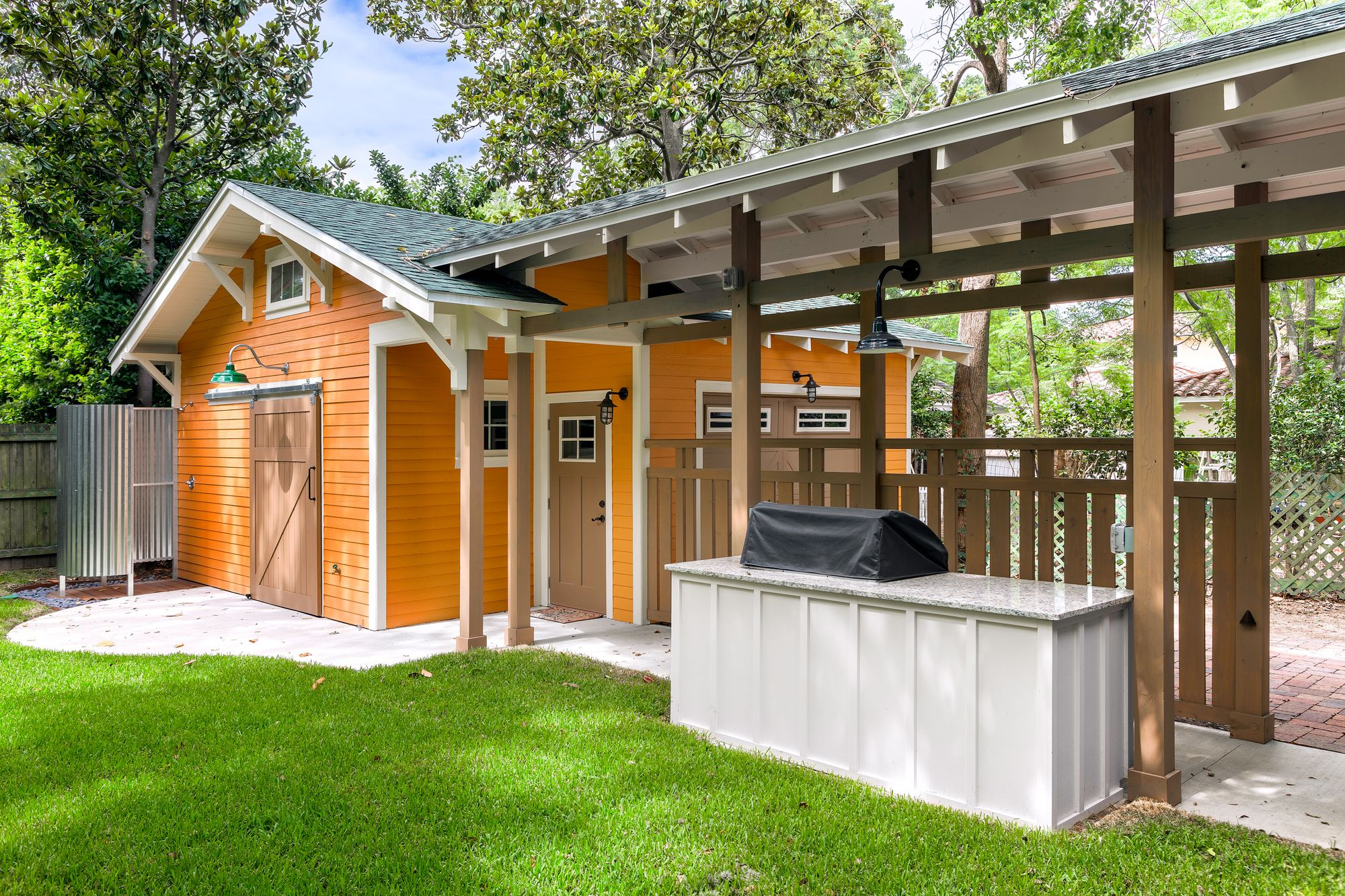outdoor cooking space and detached garage with barn door and