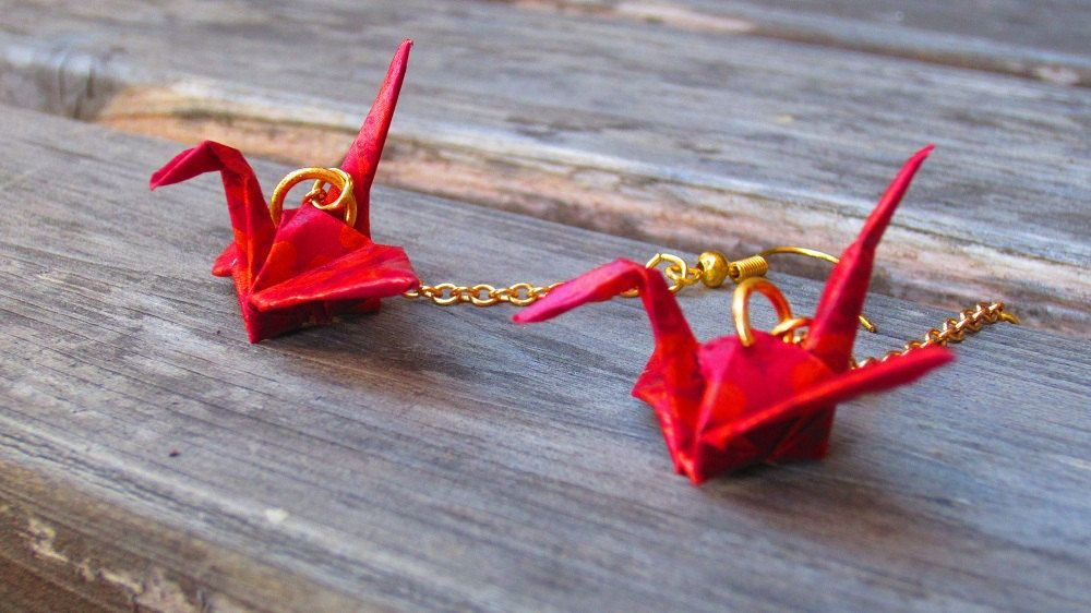 Handcrafted origami crane earrings red. $15.00, via Etsy.