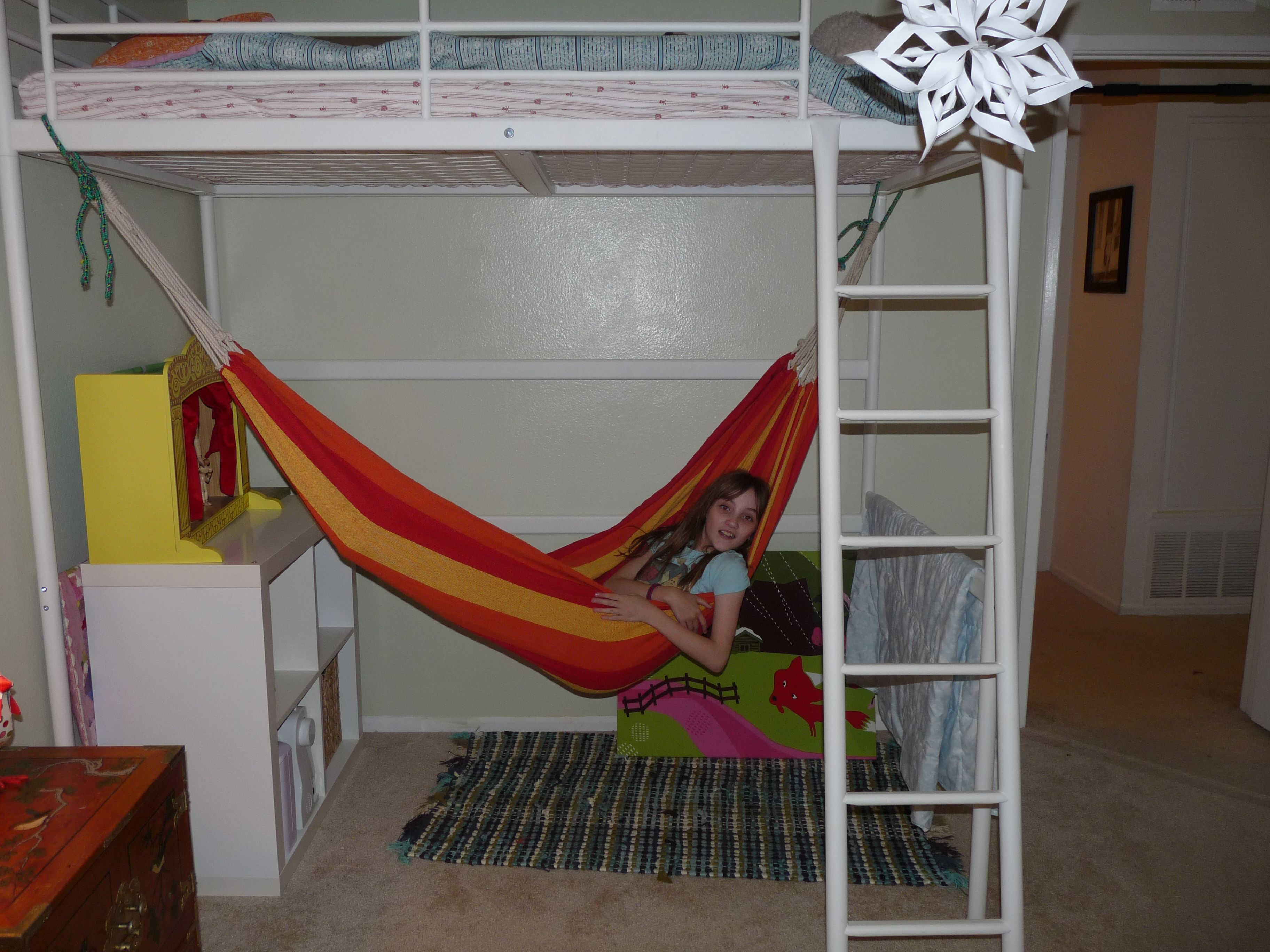 Lovely Red And Yellow Fabric Hammock Bed Under White Iron Bunk
