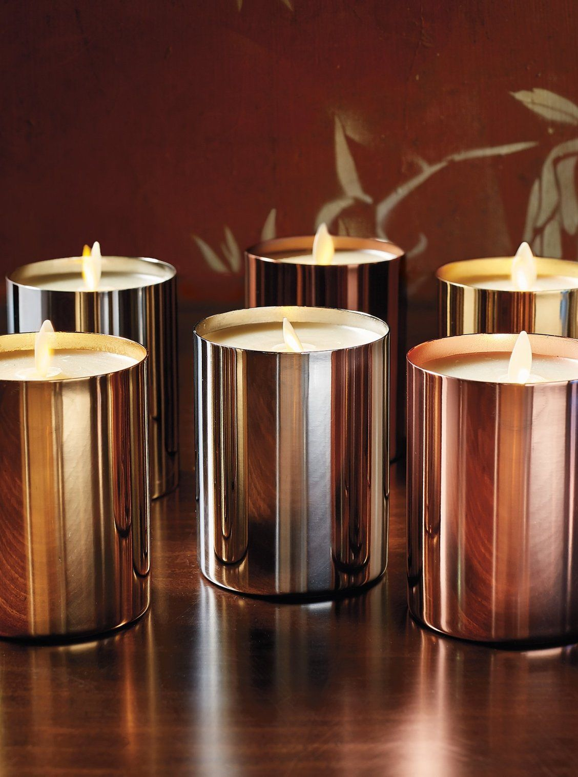Shiny Metallic Vessels Add Holiday Flair To Our Ivory Colored Faux Flame Candles Capturing The Beauty Of Candlelight In Candles Frontgate Glass Candle Holders