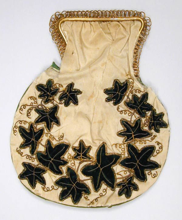 White silk reticule gathered into square top with filigree edge, piped with green satin. Embroidered with green velvet ivy sprays applied with gold couching. Lined with white silk. Handmade. c.1800.