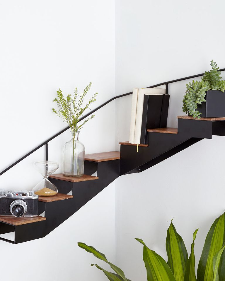 10 Totally Genius Pieces Of Furniture That Are Made For Small Spaces In 2020 Staircase Shelves Corner Bookshelves Corner Shelf Design