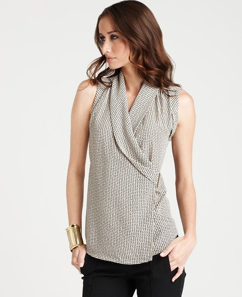 We love the easy elegance of this shawl collar blouse – it's perfectly polished for the office yet effortlessly chic for an evening out. Stylish shoulder epaulettes add a refined finishing touch. V-neckline with crossover front. Sleeveless with banded armholes.