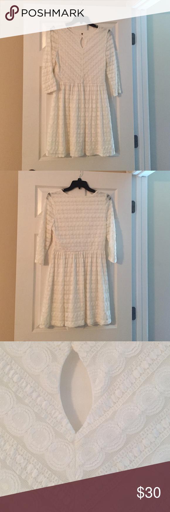 White 3/4 sleeve dress with key hole cut out White 3/4 sleeve dress with key hole cut out Pink Owl Dresses Long Sleeve