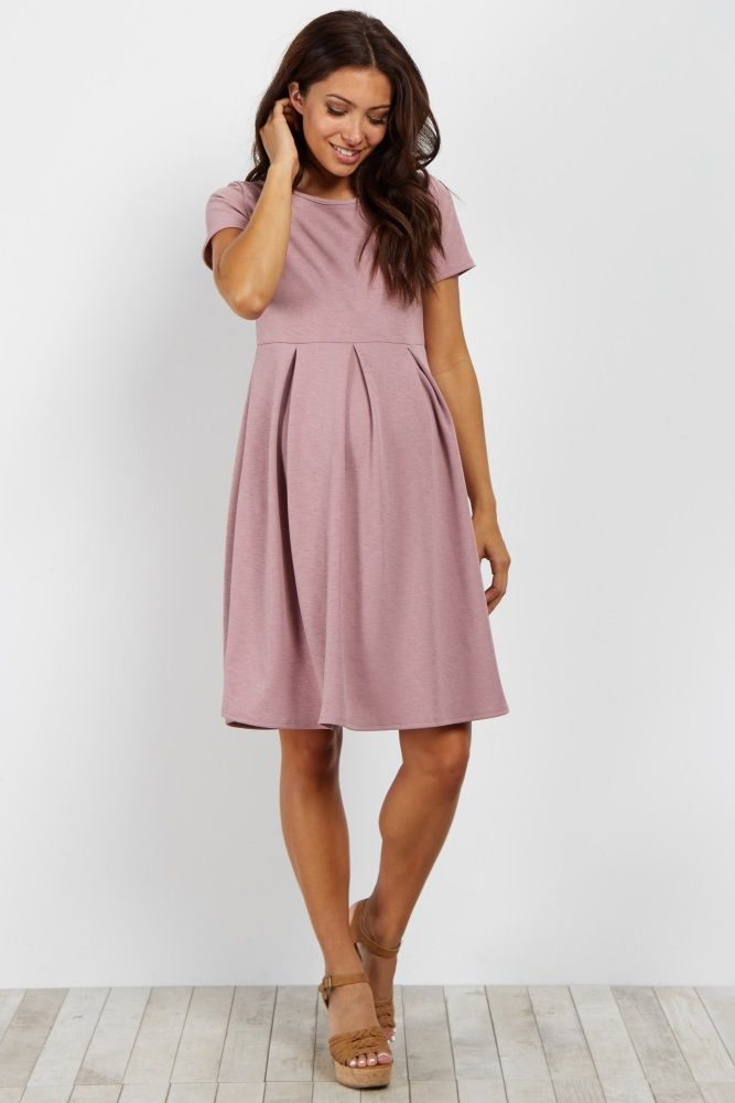 99c45133e2 We are in love with this basic style that is perfect to dress up or down  for any occasion. This versatile maternity dress features neat pleats and  short ...