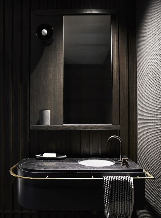Modern Bathroom Space With Dark Wood Panels A Black Marble Counter