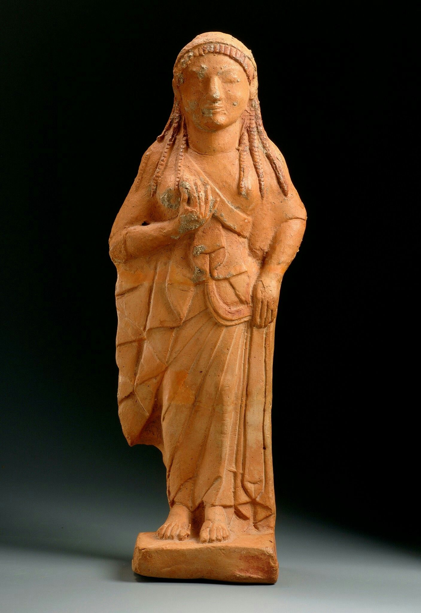 Terracotta Statuette Of Kore. East Greek. Archaic Period. Late 6th Century . Phoenix