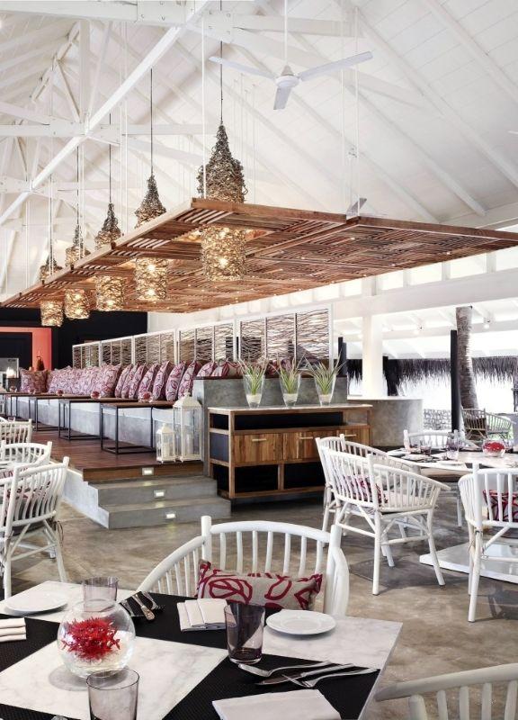 The vivanta restaurant features high ceilings and