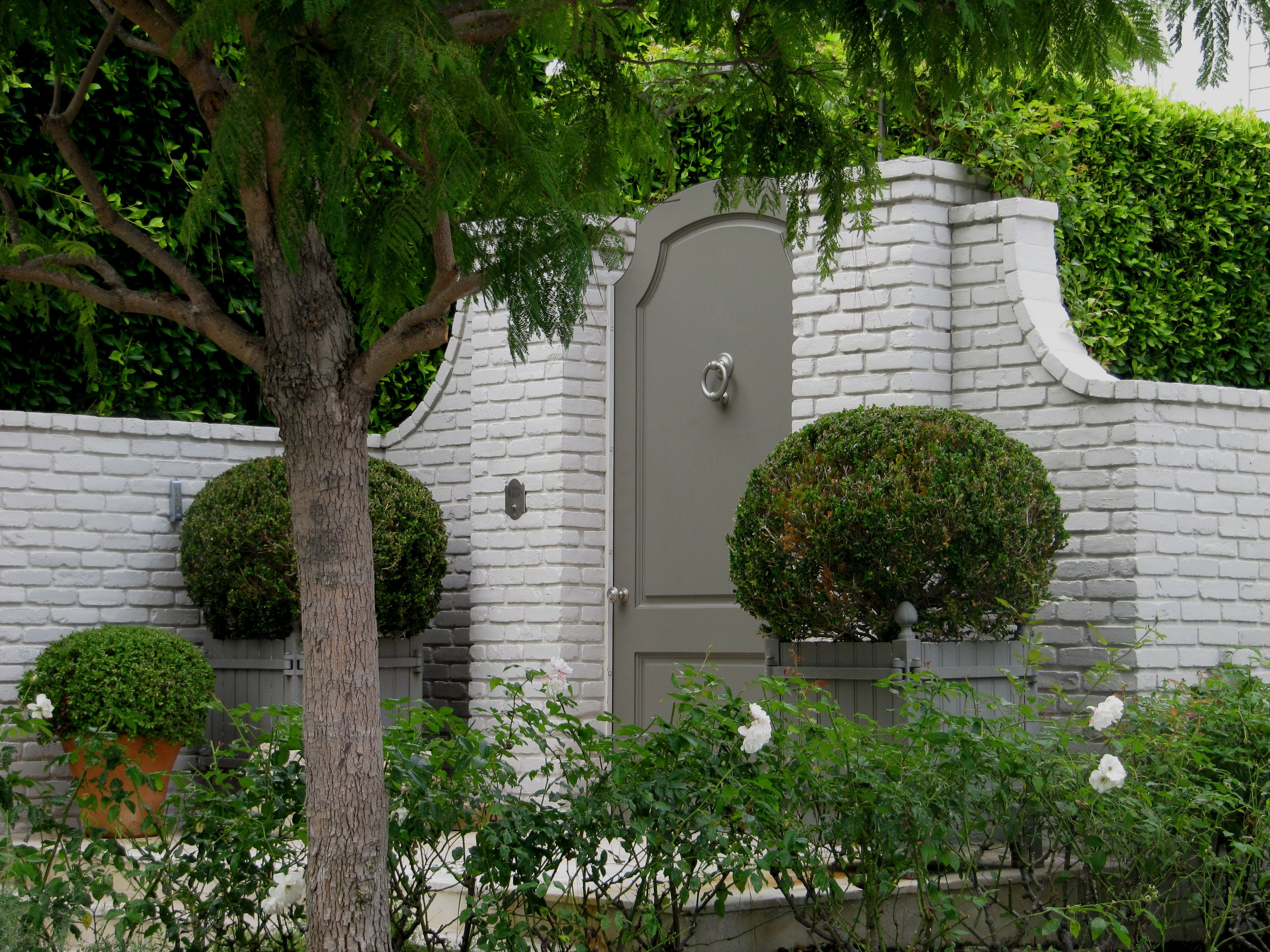 Superb garden wall 3 decorative brick garden walls garden walls elegant painted garden gate in painted brick wall boxwood in wood planters amipublicfo Images
