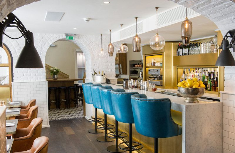 Even small commercial spaces can inspire great #design. This #bar is amazing (especially the pendant #lighting!)