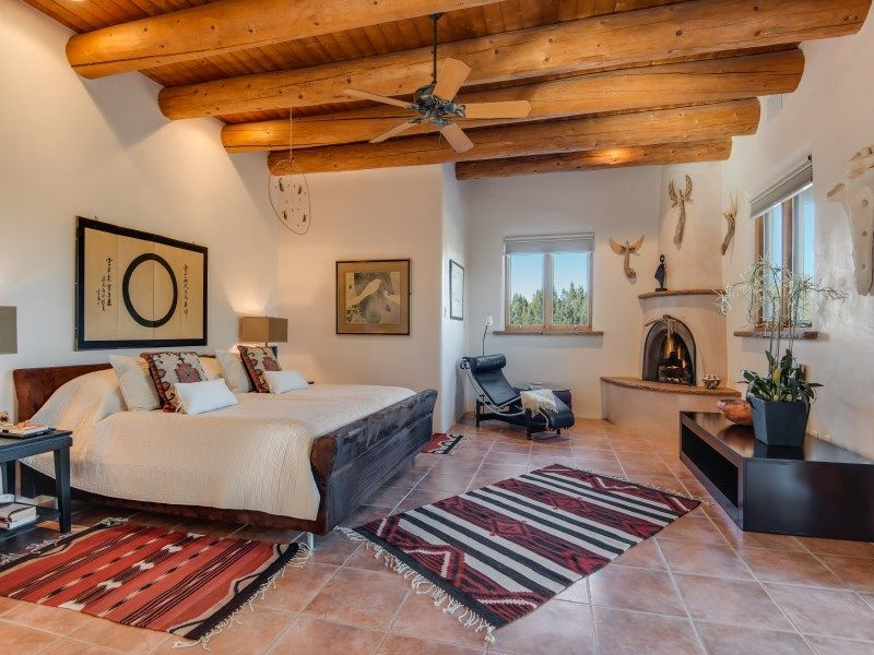 Southwestern master bedroom with high ceiling ceiling fan cement southwestern master bedroom with high ceiling ceiling fan cement fireplace exposed beam mozeypictures Image collections