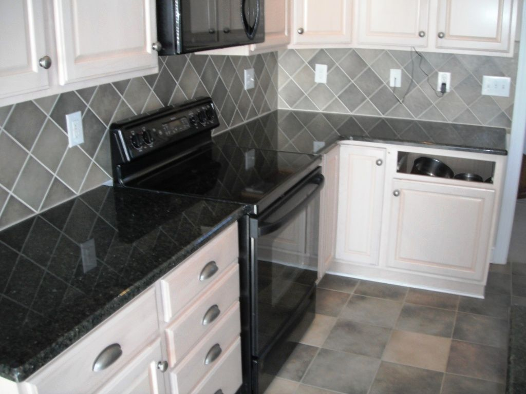 - Ceramic Tile Backsplash White Cabinets And Black Ubatuba Granite