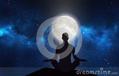 man silhouette in yoga lotus pose practicing meditation