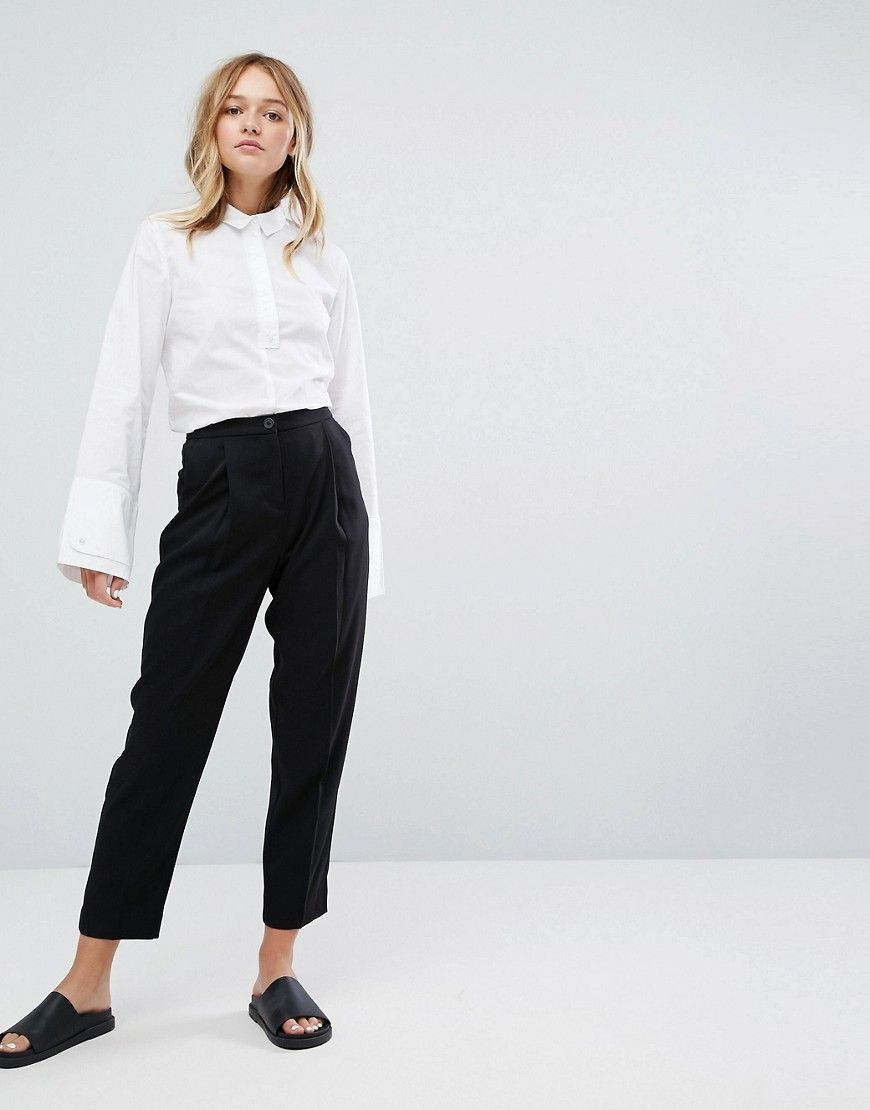 c196a55d53f4a Get this Monki s high waist trousers now! Click for more details. Worldwide  shipping. Monki High Waist Peg Leg Trousers - Black  Trousers by Monki, ...