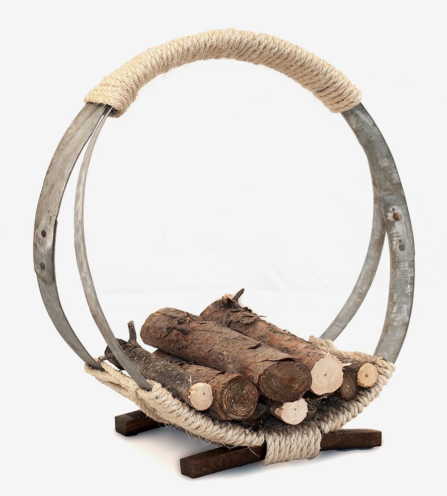 stack wine barrels. Wine Barrel Hoop Firewood Rack | Stack All Of Your Wood For The Fire In This Barrels