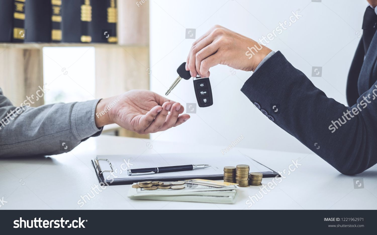 Salesman Send Key To Customer After Good Deal Agreement Successful Car Loan Contract Buying Or Selling New Vehicle Royalty Fr Car Loans Balance Transfer Loan