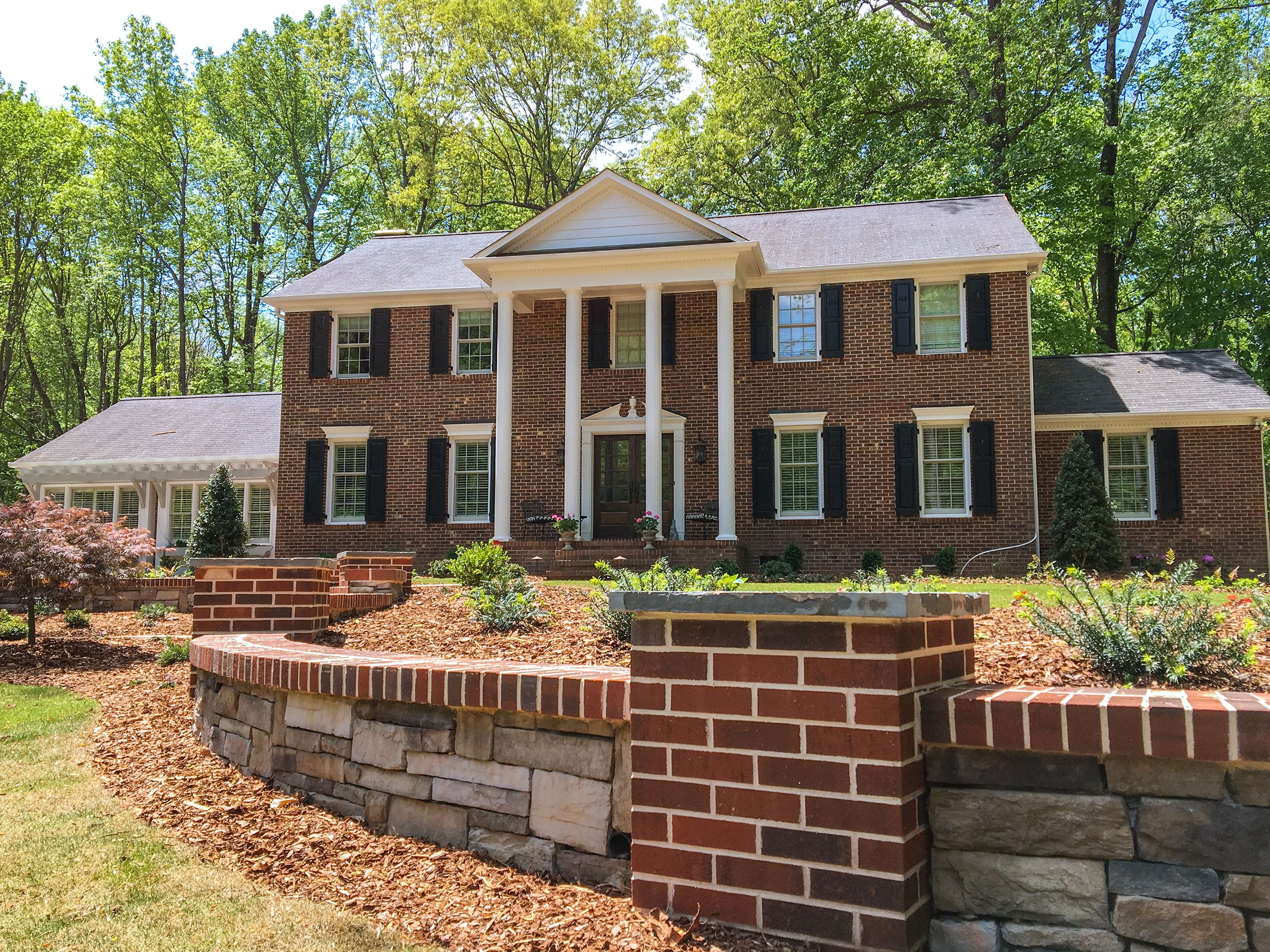 Classic Colonial Home Artfully Landscaped With Curvy Brick And Stone Wall And Walkway Entrance Brick And Stone Brick Colonial House