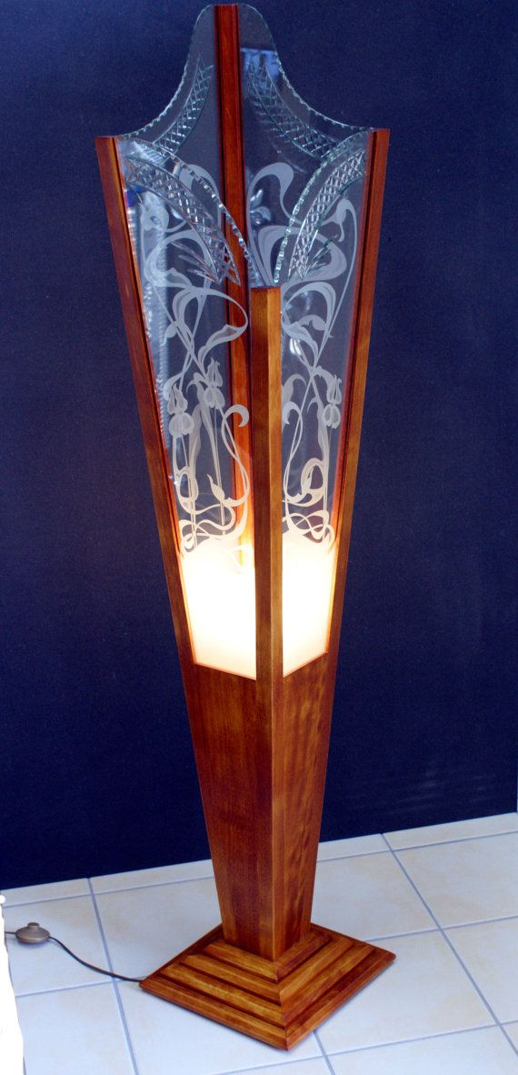 This is a lamp that fits into the art nouveau category. It has a natural form and structure. -Emma Krenzer