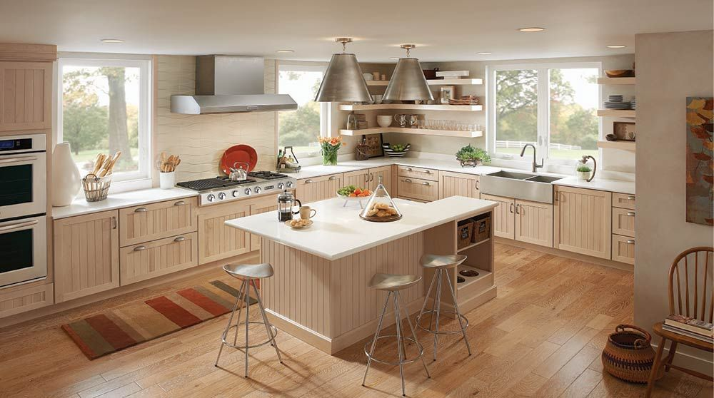 Love the colors - light wood and white countertops ...