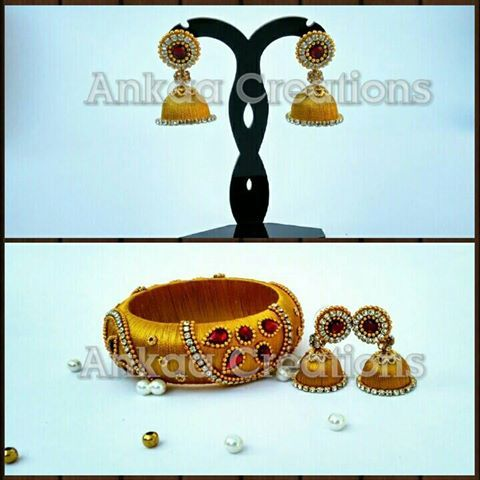 silk thread bangle and jhumka set .. customized and sold.. can be reamde.. for orders and details whatsapp us @ 8050398758  plz visit our page and give us a like https://m.facebook.com/ankaa.creations