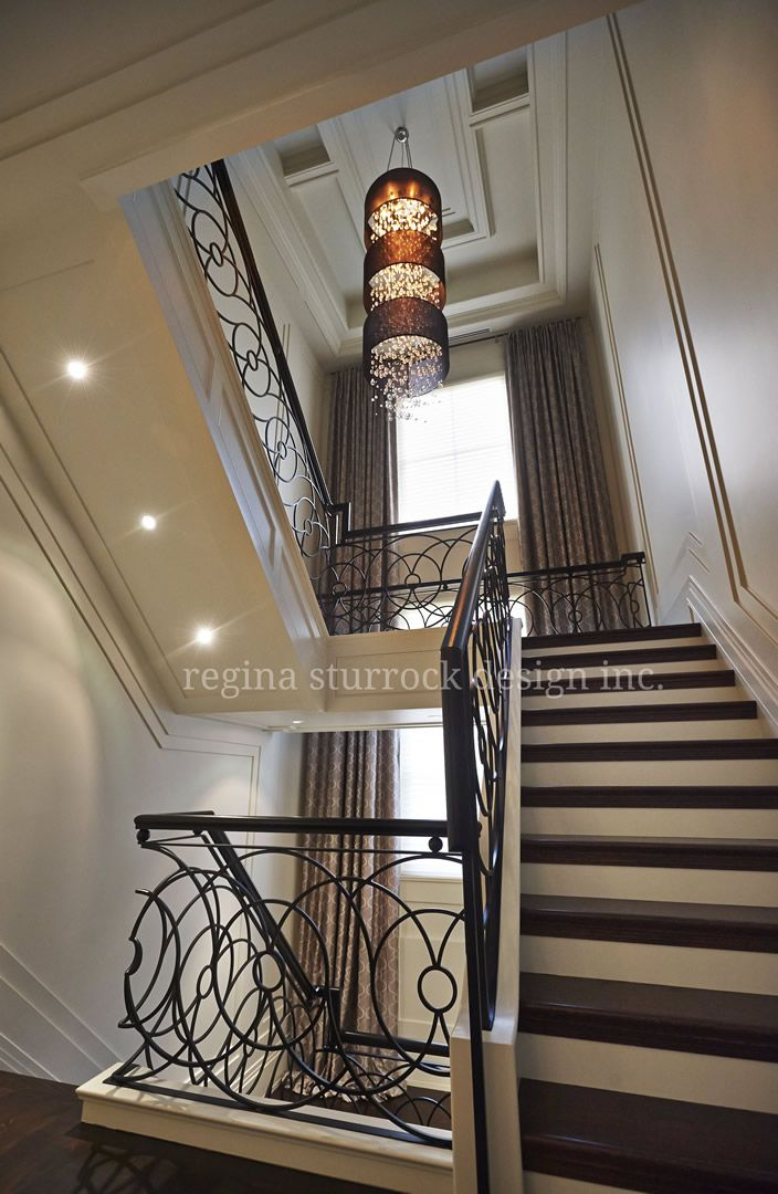 This custom ironwork railing is full of energy movement for Interior designs regina