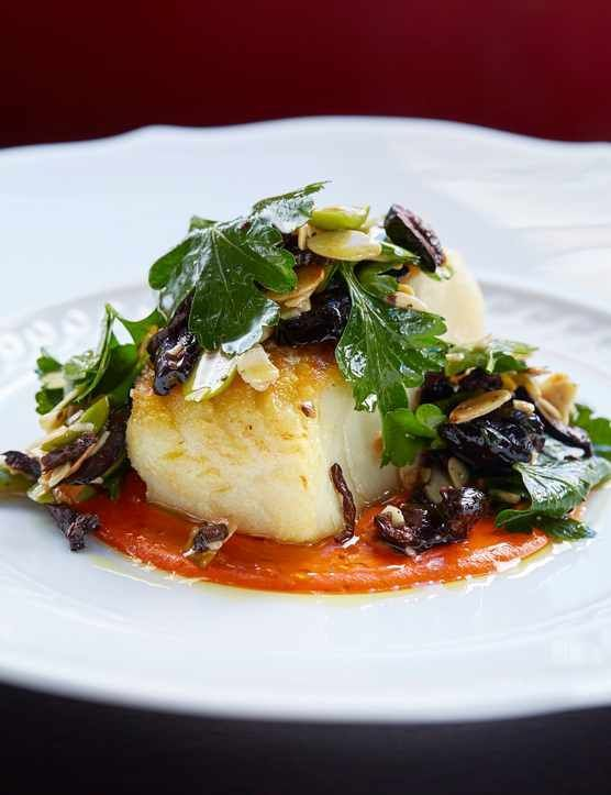 Photo of Roast cod and romesco sauce with olive and almond dressing