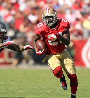 They say that baseball is the all american sport. Seems a little slow and over-rated, but maybe thats just me. In the picture you see Frank Gore running for a touchdown, with someone just about to foil his plans.Football really is the national past-time, at least in this century.